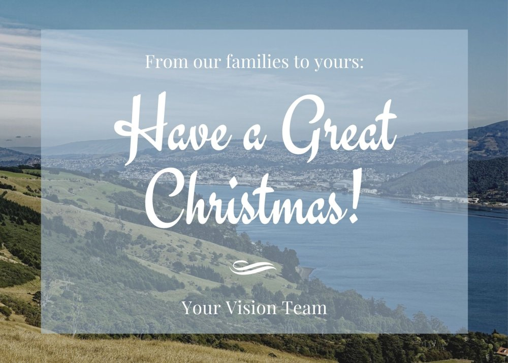 Aerial view of Dunedin and Otago Harbour in the background, seasons greetings overlay